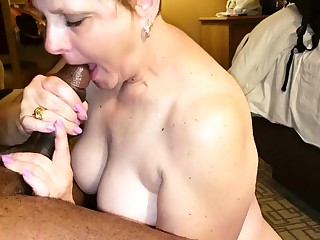 Stacked mature housewife wraps her lips around a black shaft