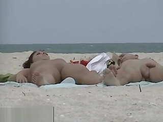 Very simmering milf rubbing boobs in nude beach