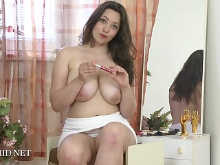 Playing with her heavy natural pair