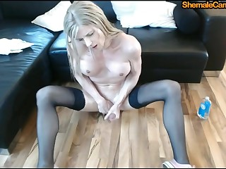 Beautiful blonde shemale hither stockings with big tits goes wild while masturbating