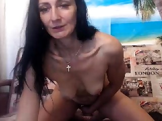 Camouflaged mature solo masturbation