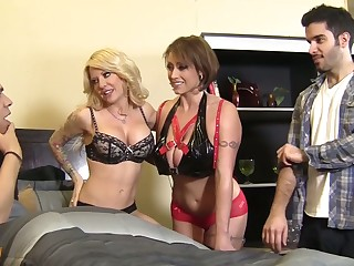 One well stacked sluts give a excellent tugjob to one kinky dude