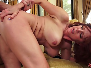 Redhead matured with big knockers Andi James in hardcore with cumshot