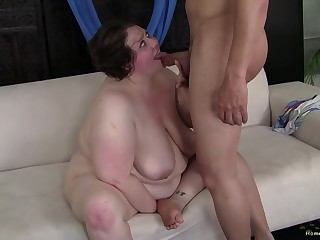 Fat wife with hairy pussy fucked on an obstacle bed and receives a cumshot