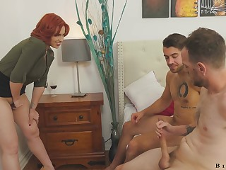 Busty redheaded trainer Edyn Blair enjoying some hot hermaphrodite threesome