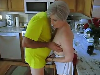 Grey haired mature whore lets her soft-pedal play with her small tits